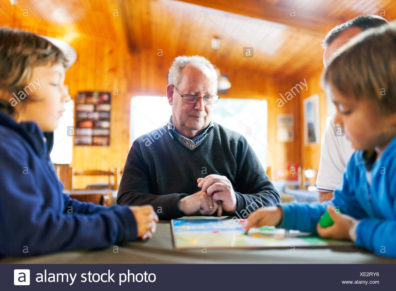 Senior man playing with his grandsons Stock Photo