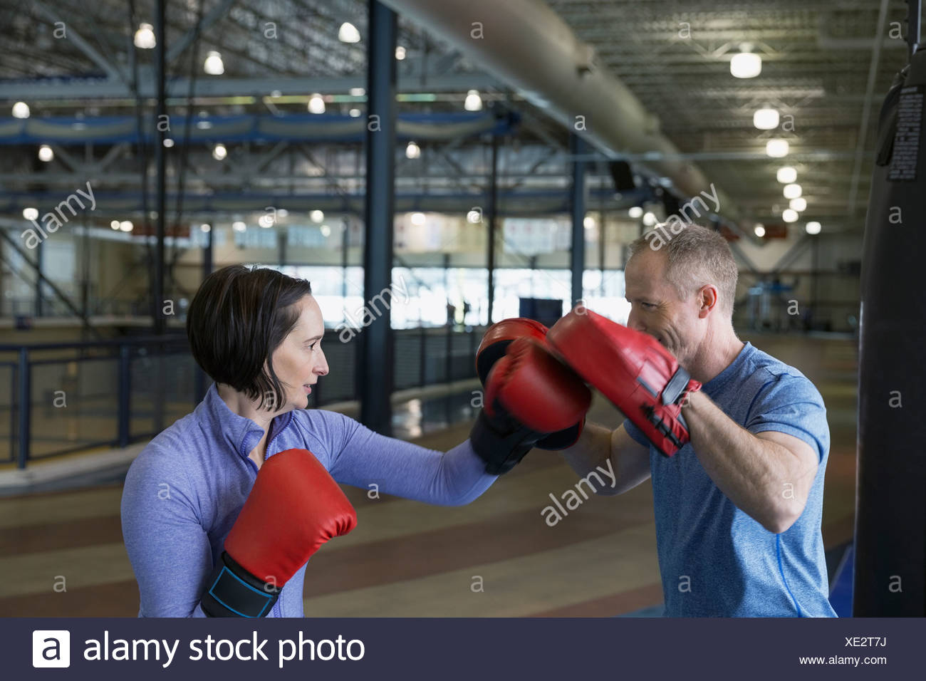 Woman boxing with personal trainer - Stock Image