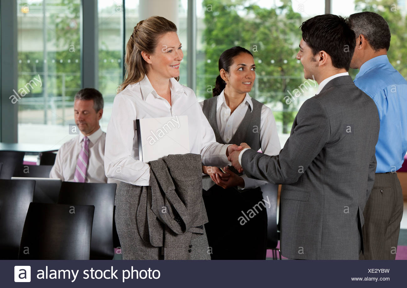 Businesspeople shaking hands - Stock Image