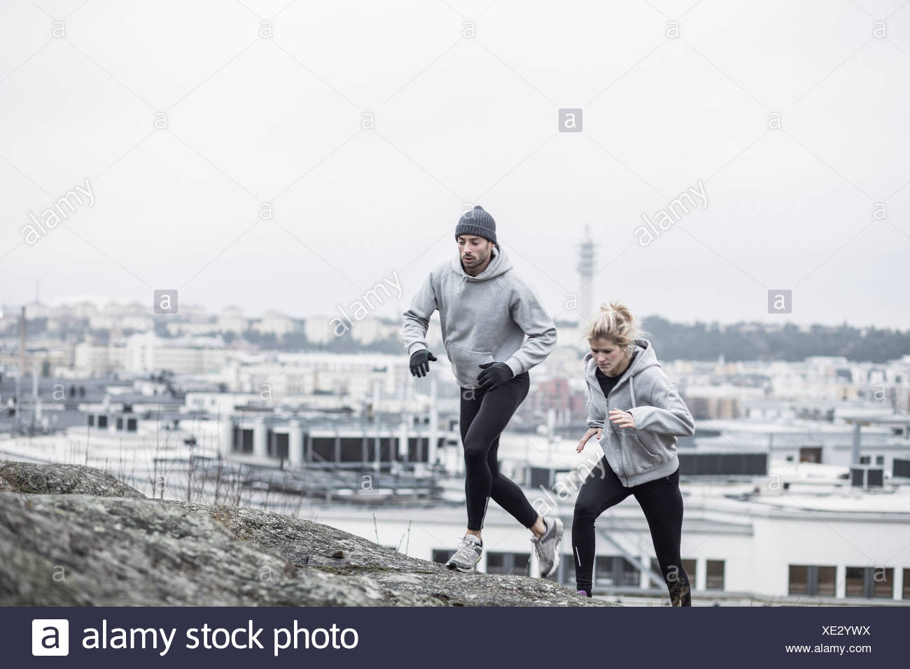 Sporty couple jogging together Stock Photo