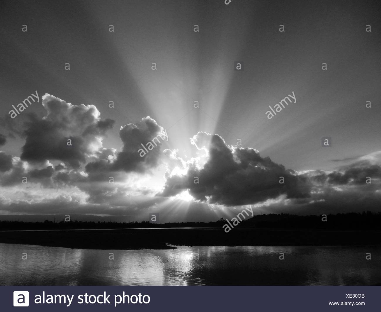 God's Rays Above River - Stock Image