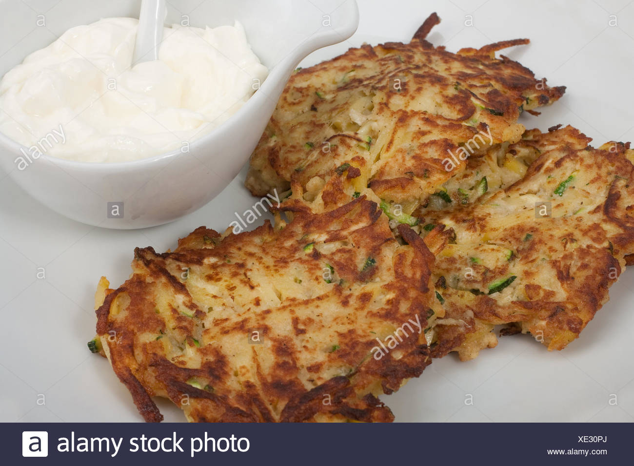 potato and courgette fritters with dip - Stock Image