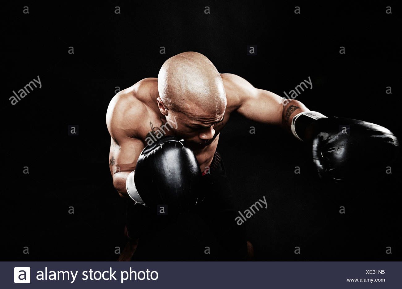 Boxer punching Stock Photo