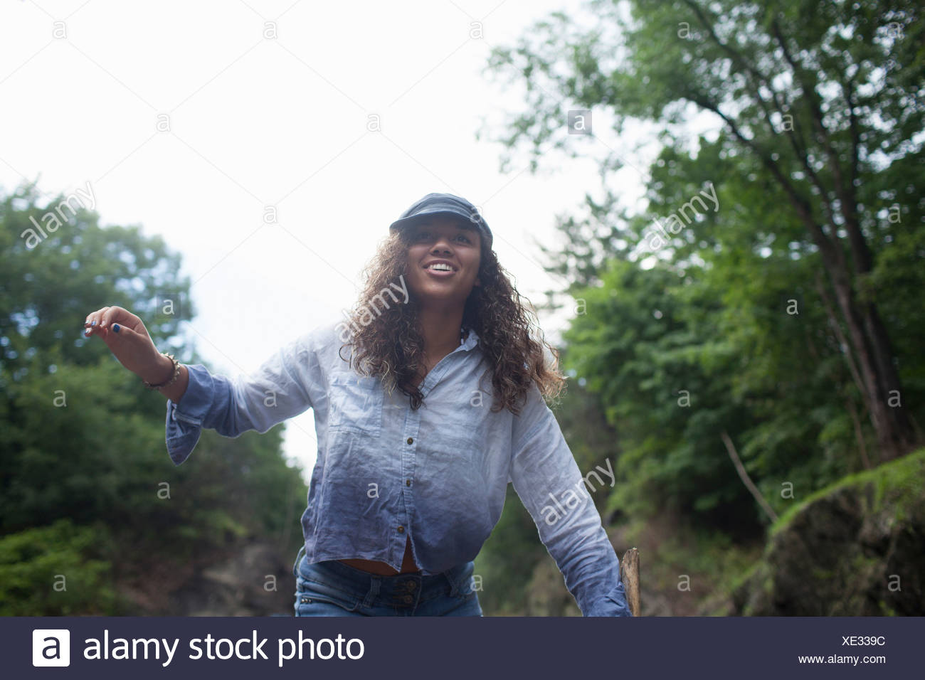 Teenage girl walking outdoors - Stock Image