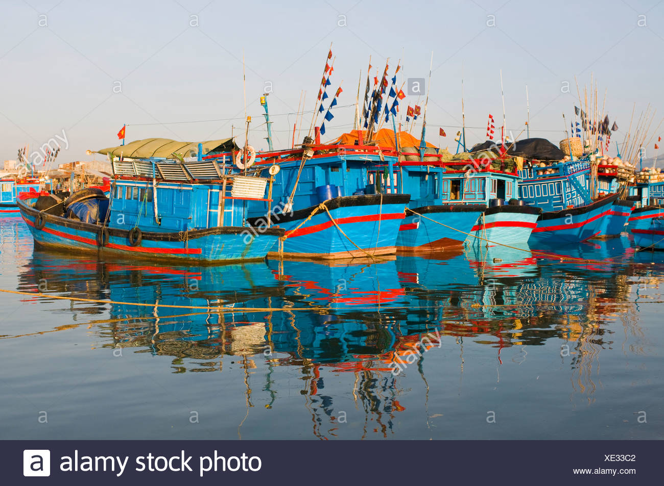 Blue fishing boats in the harbour of Nha Trang, Vietnam, Asia - Stock Image