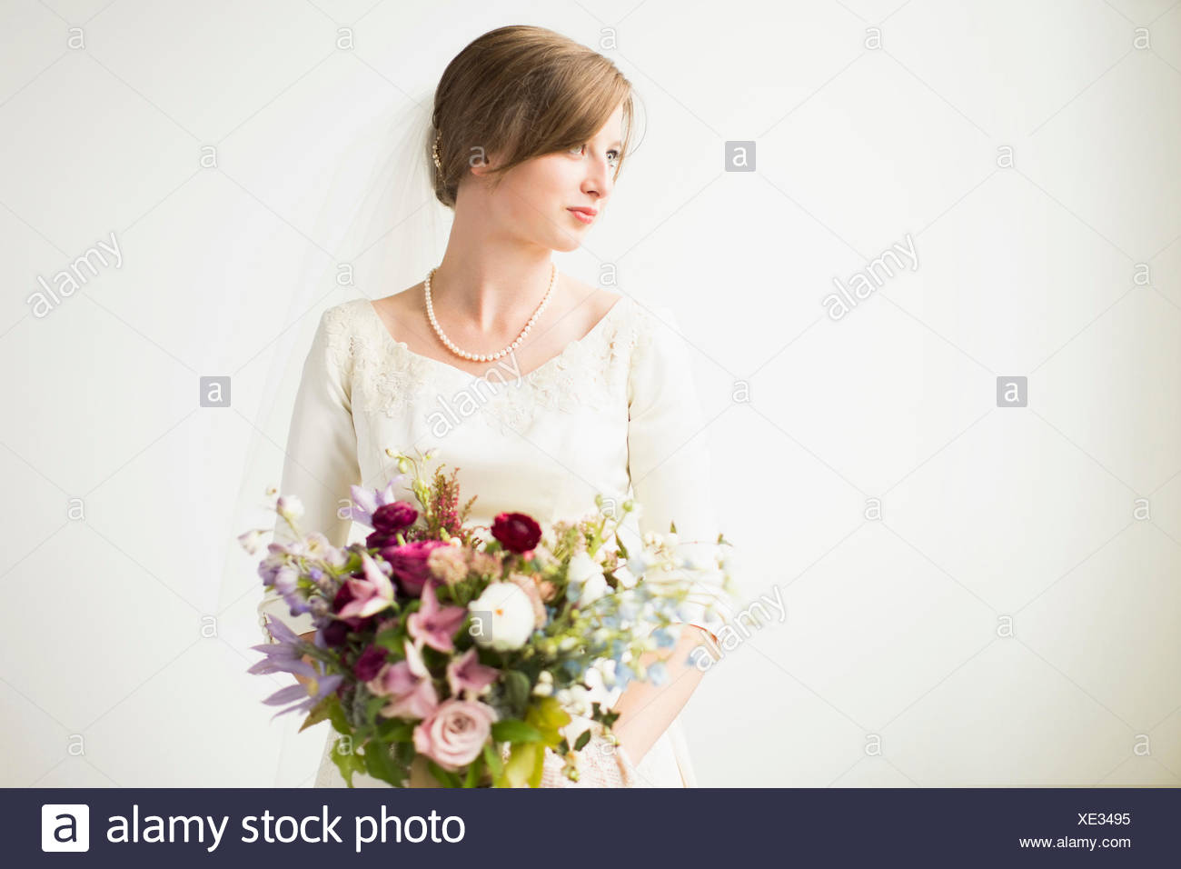 Portrait of bride with wedding bouquet - Stock Image