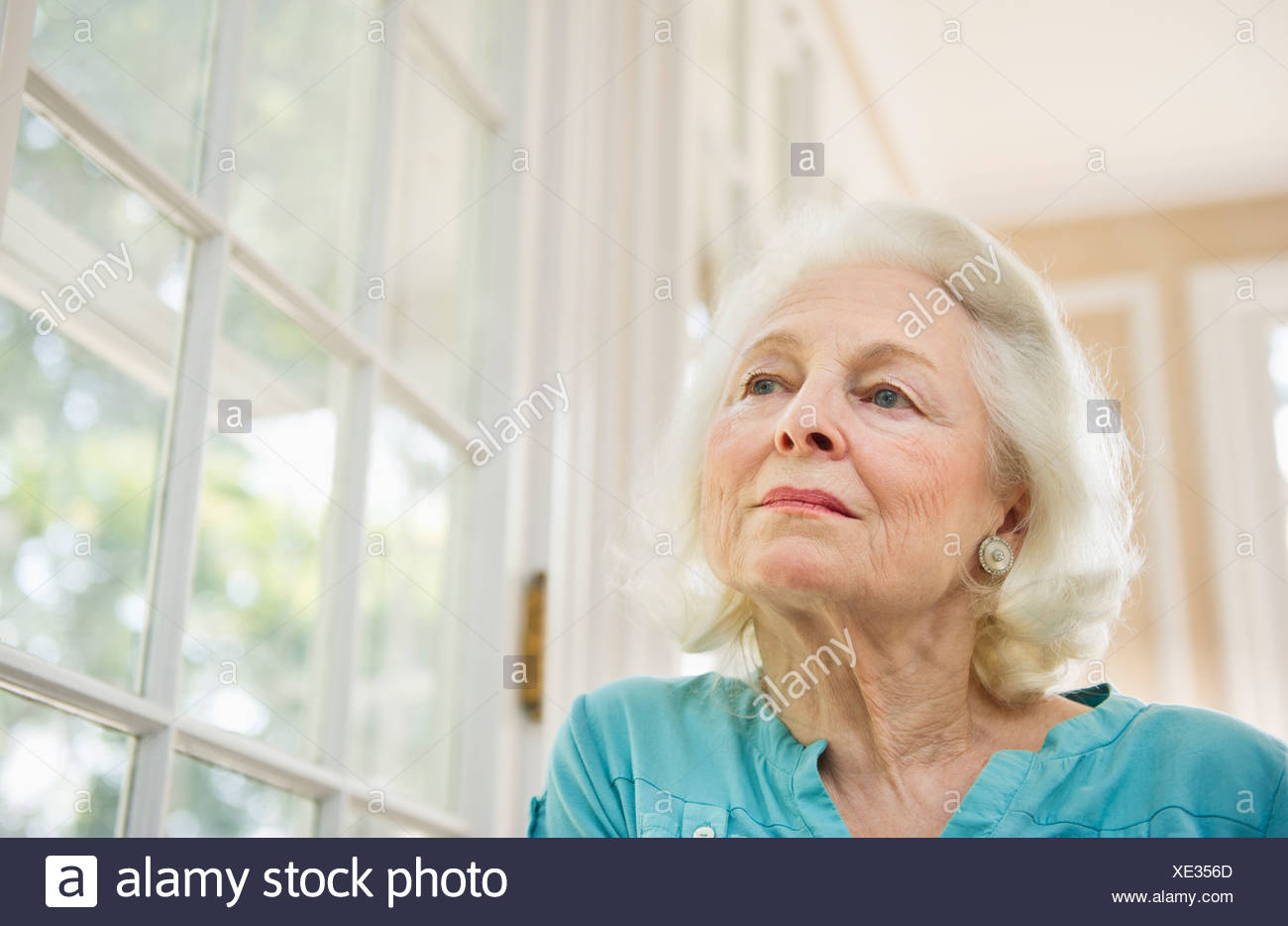 USA, New York State, Old Westbury, Portrait of pensive senior woman - Stock Image