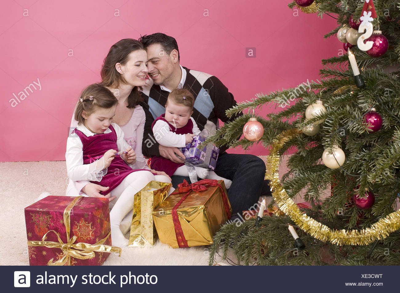 Family, happily, Christmas tree, presents, - Stock Image