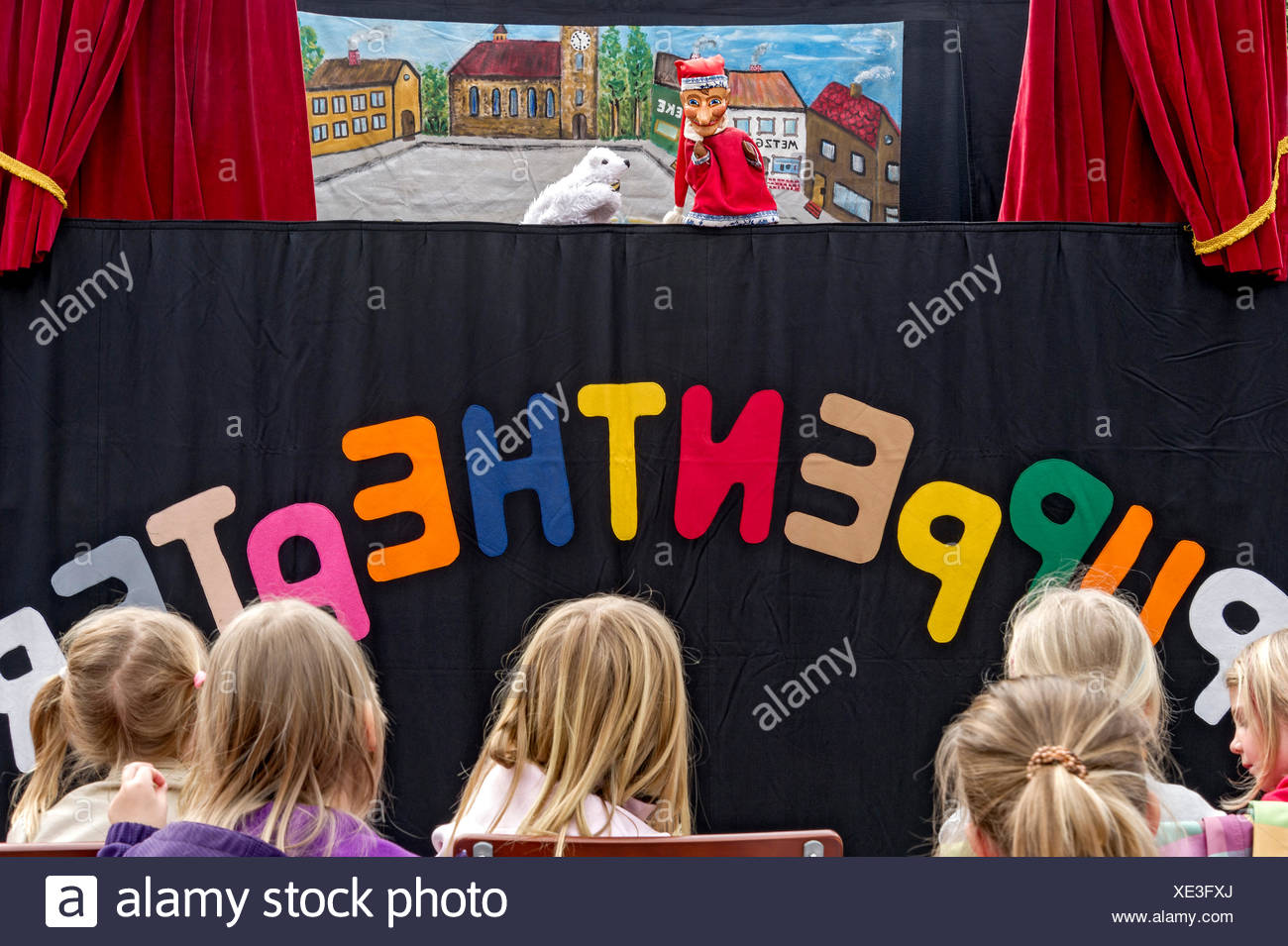 Children watching the puppet theater, Upper Bavaria, Bavaria, Germany - Stock Image