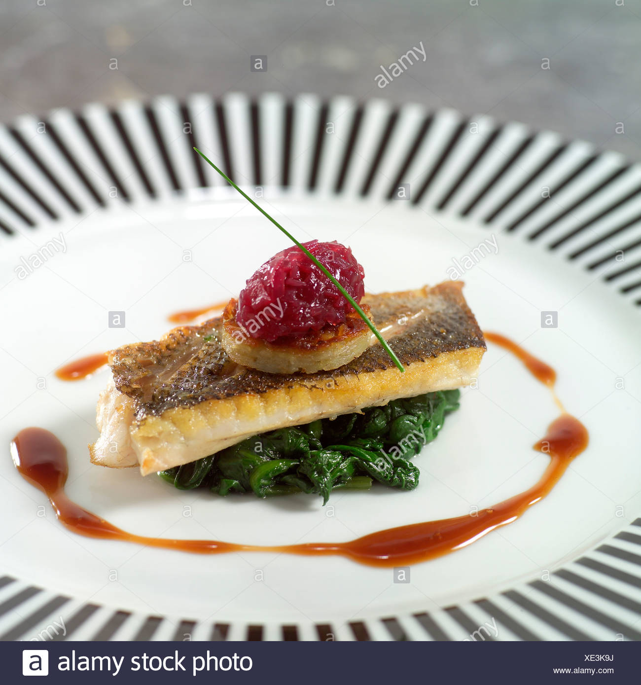 Fish Starter with spinach - Stock Image