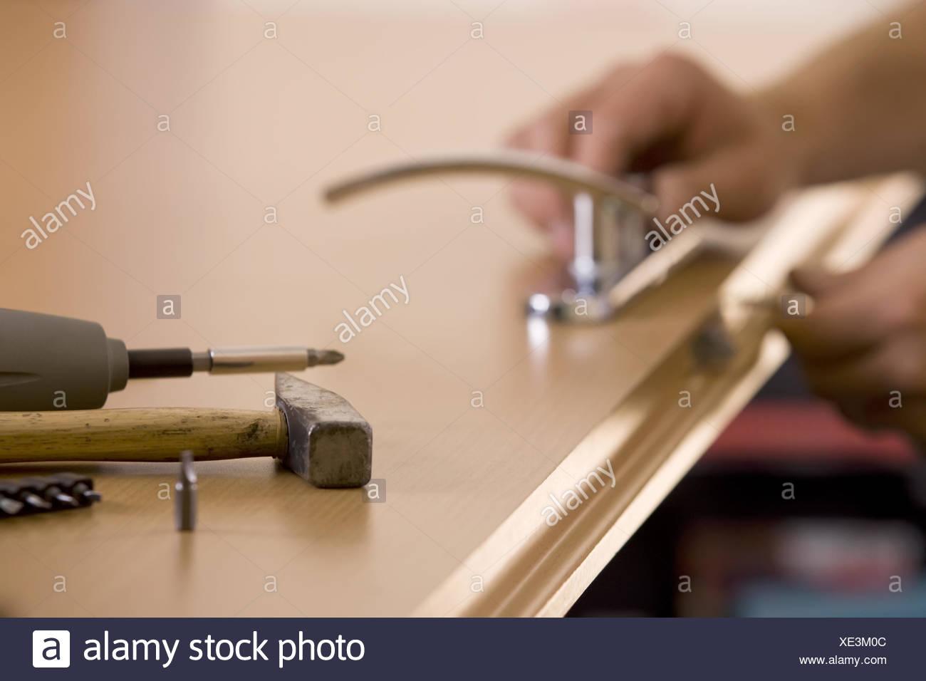 man#39;s hands is exchanging lock - Stock Image