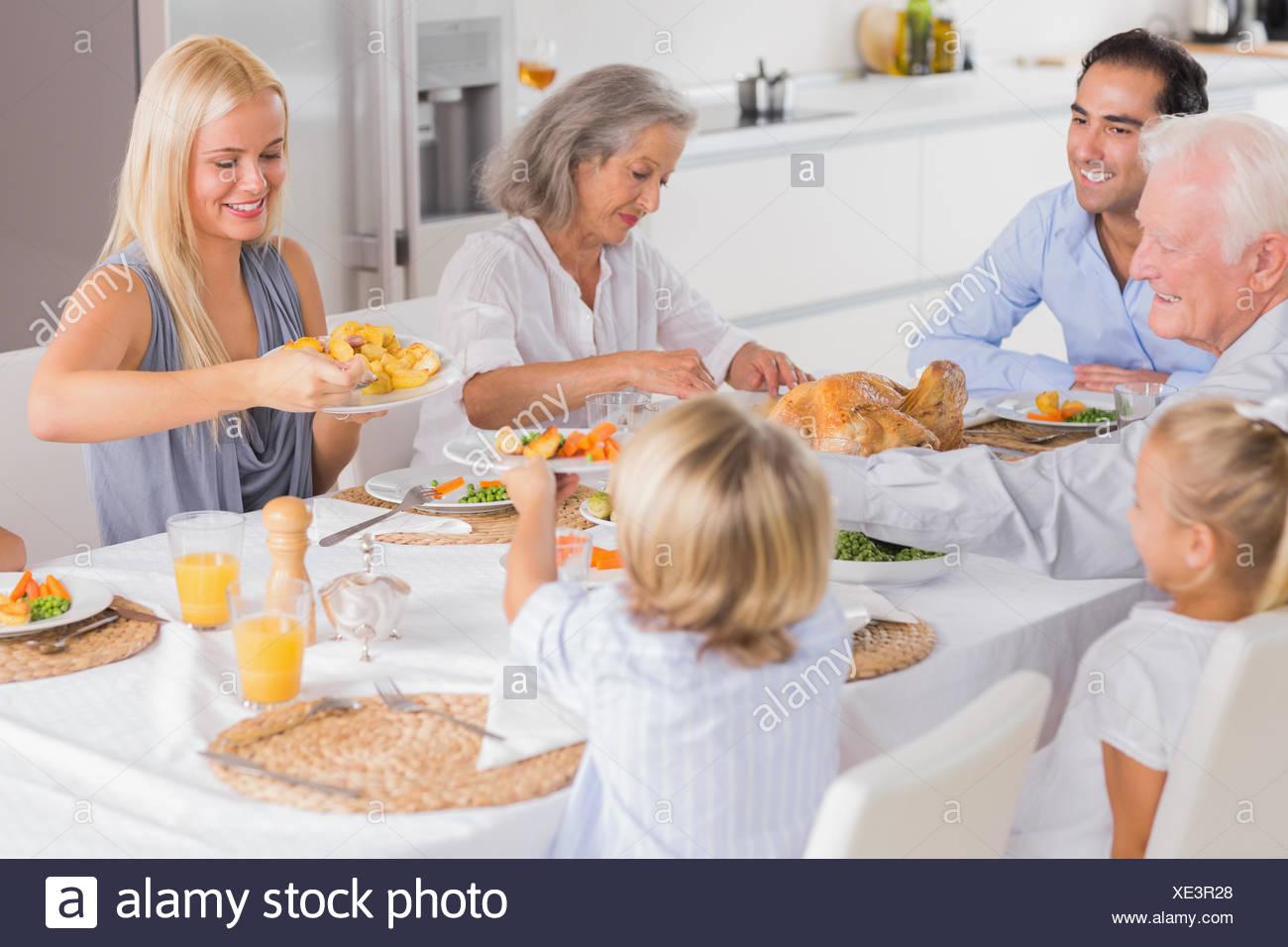 Happy Family Eating The Thanksgiving Dinner Stock Photo 284055024