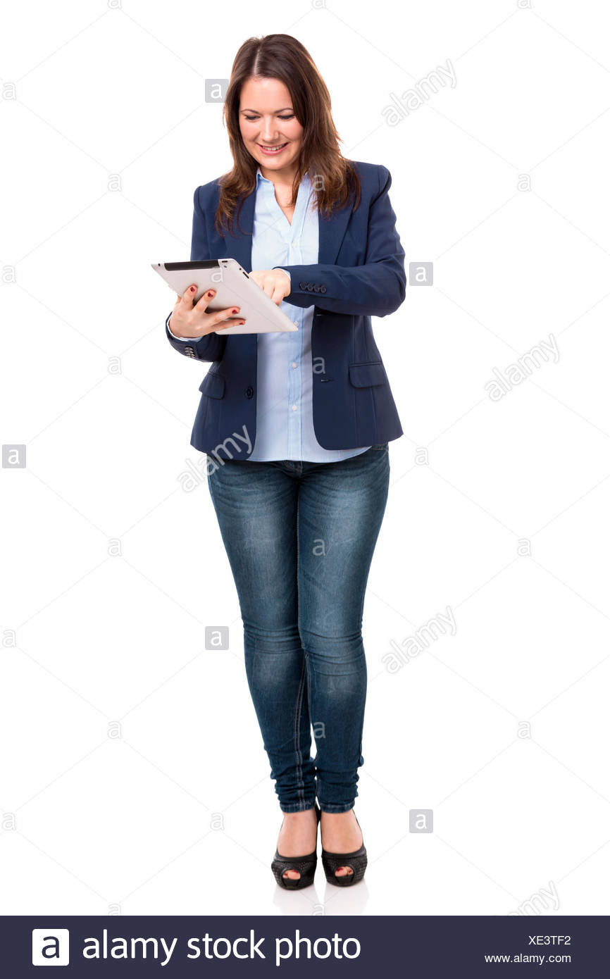 Business woman working with a tablet - Stock Image