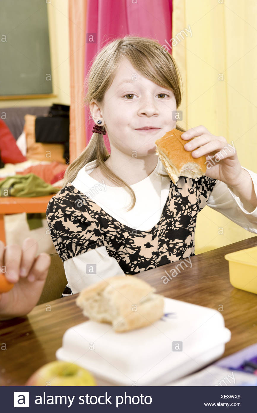 Classrooms, pause, schoolgirl, eating, portrait, - Stock Image