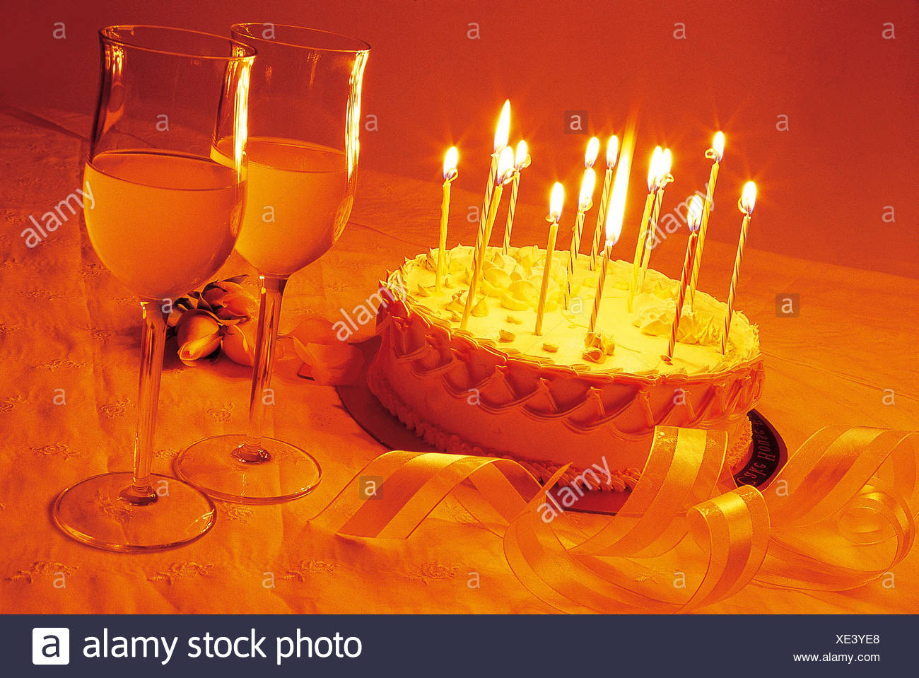 Birthday Cake And Wine Glasses On The Table