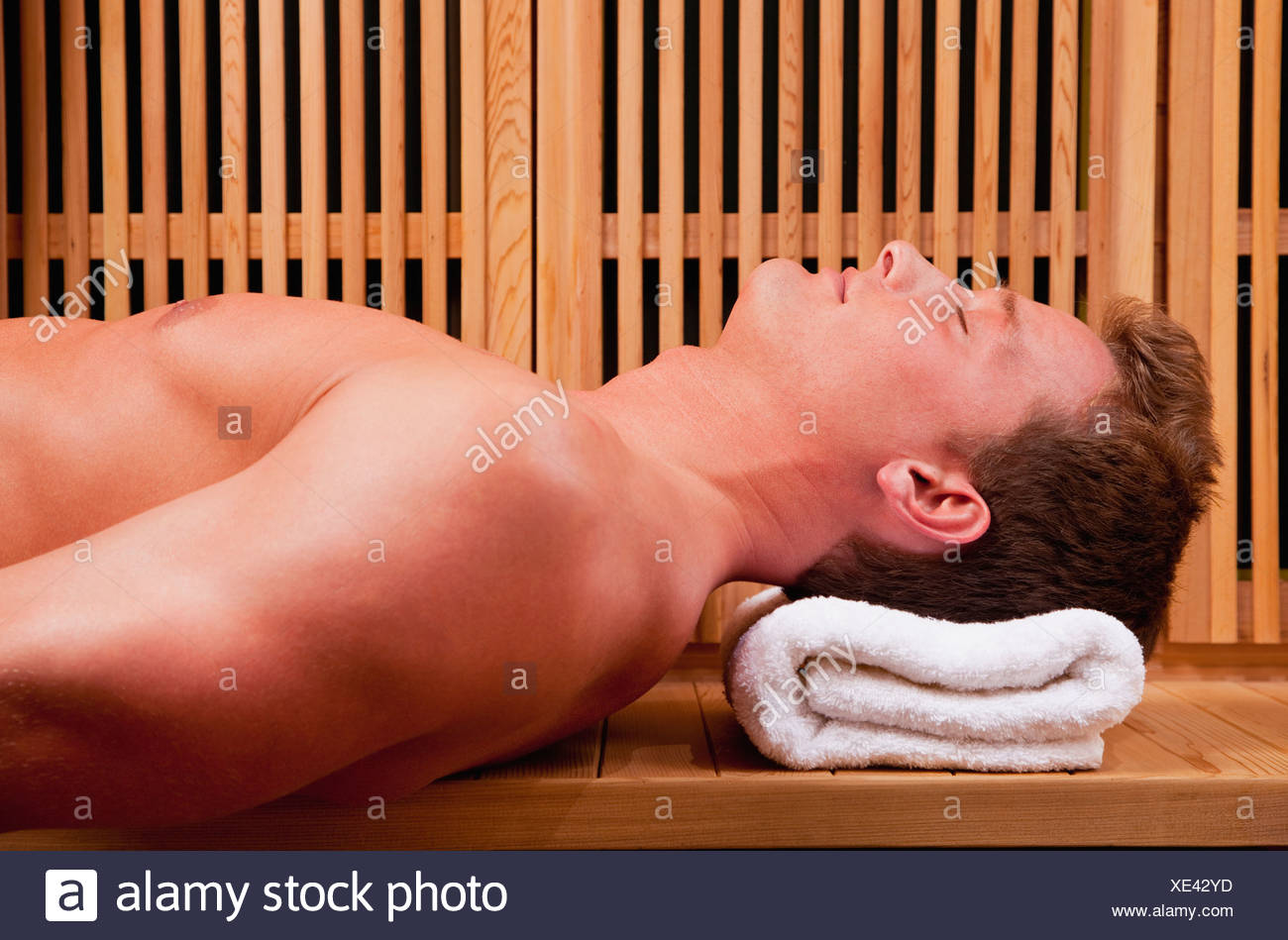 Young man in sauna - Stock Image