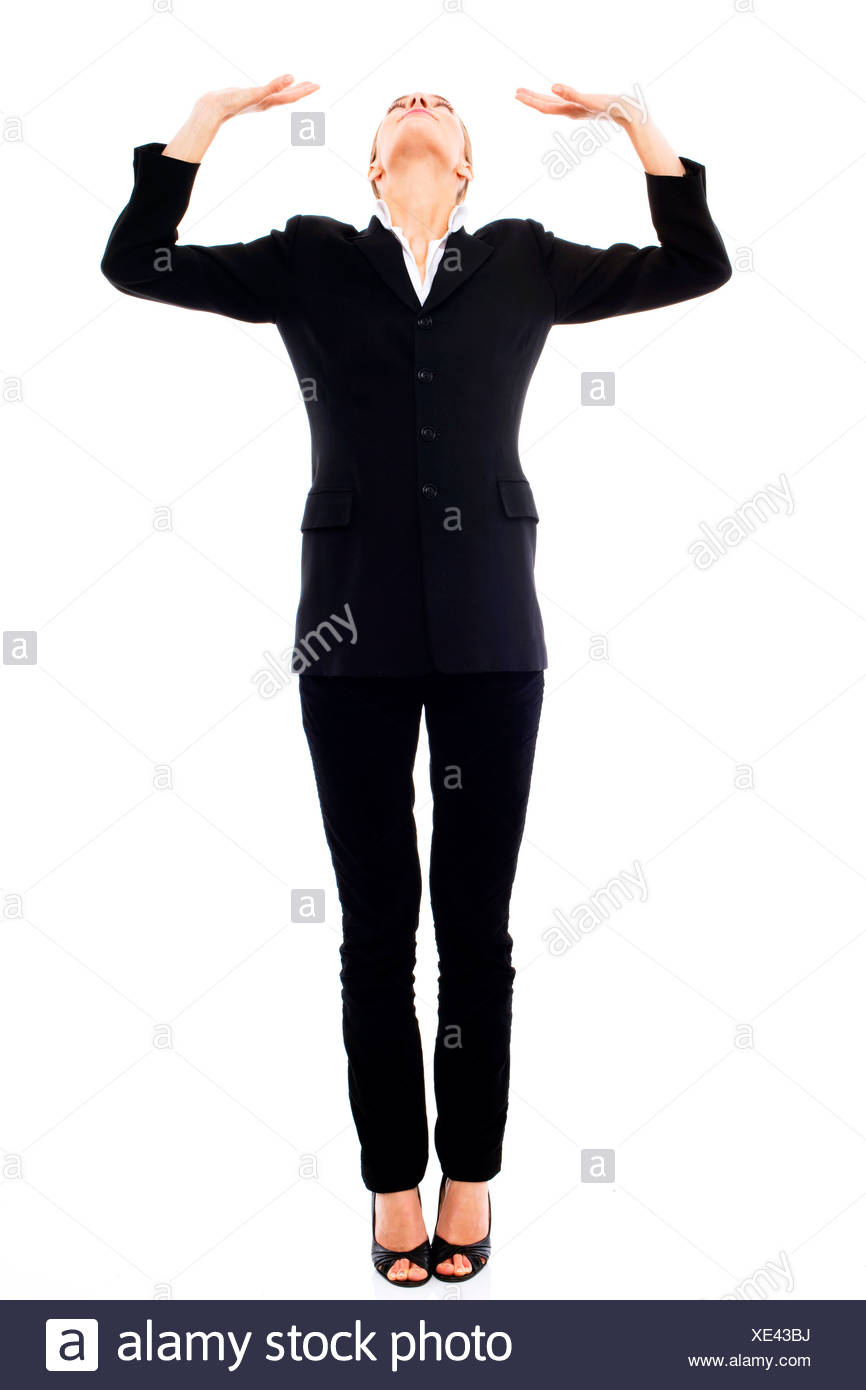 Young businesswoman oppressed on white background studio - Stock Image