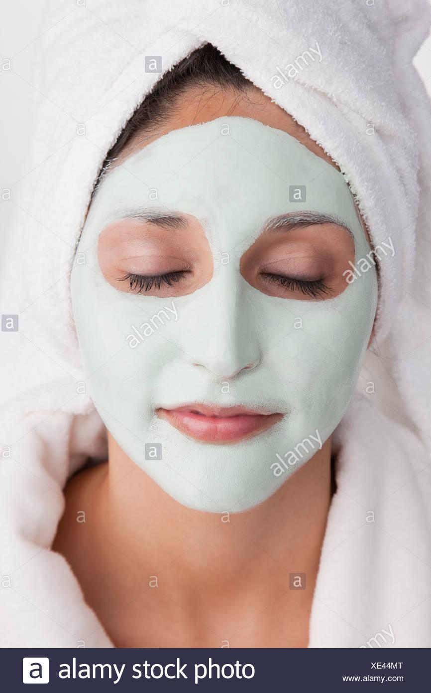 Young woman having facial mask - Stock Image