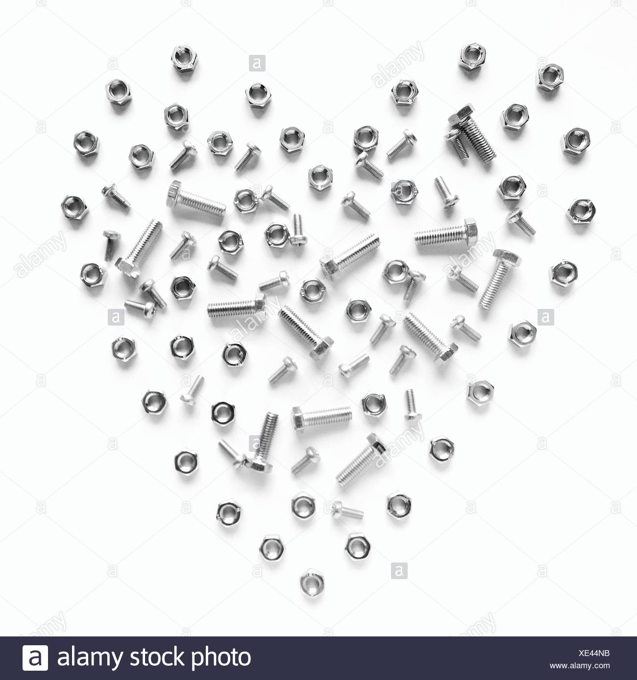 Heart Shape Made From Nuts And Bolts On White Background Stock Photo