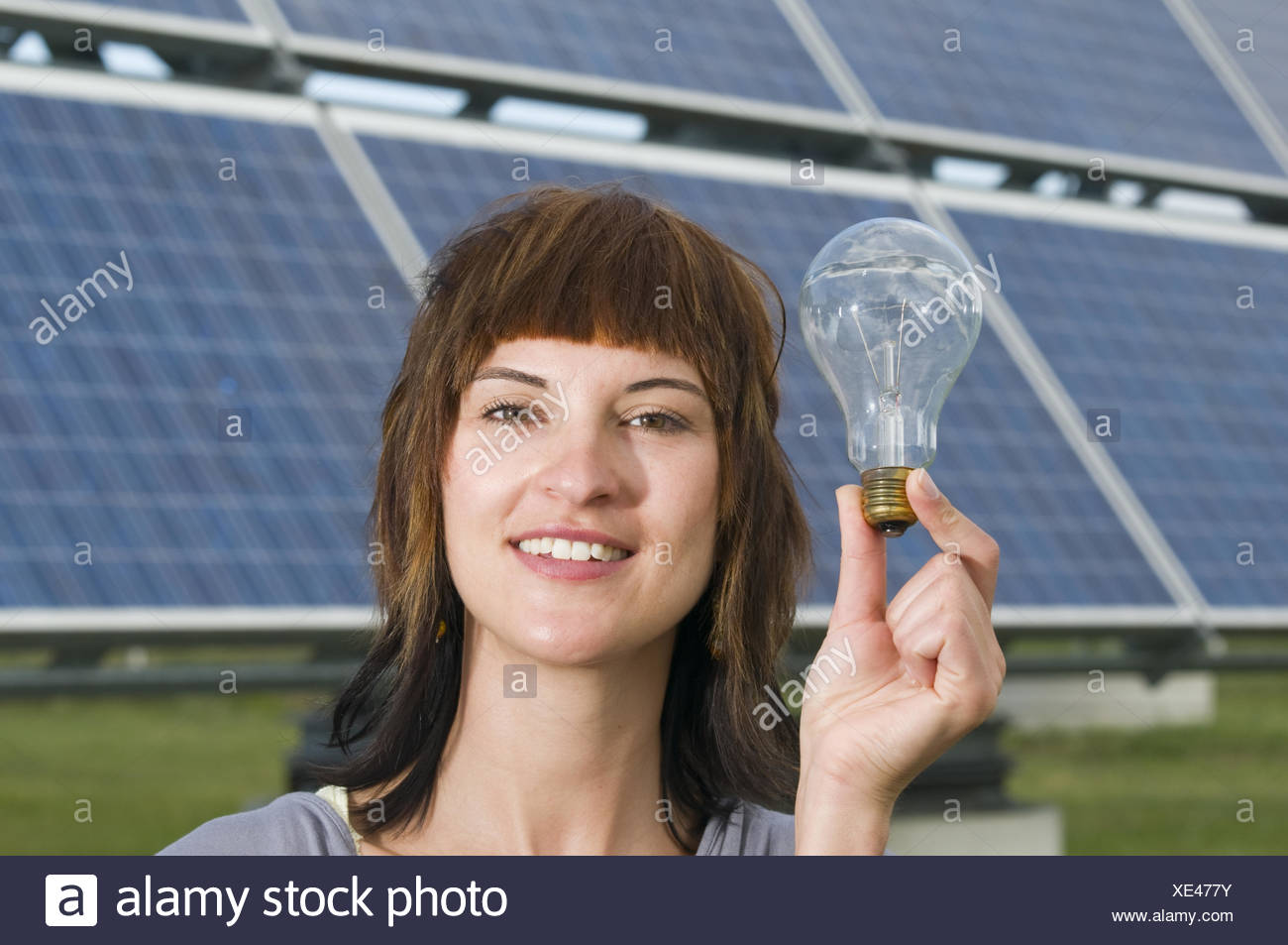 woman hold the bulb - Stock Image