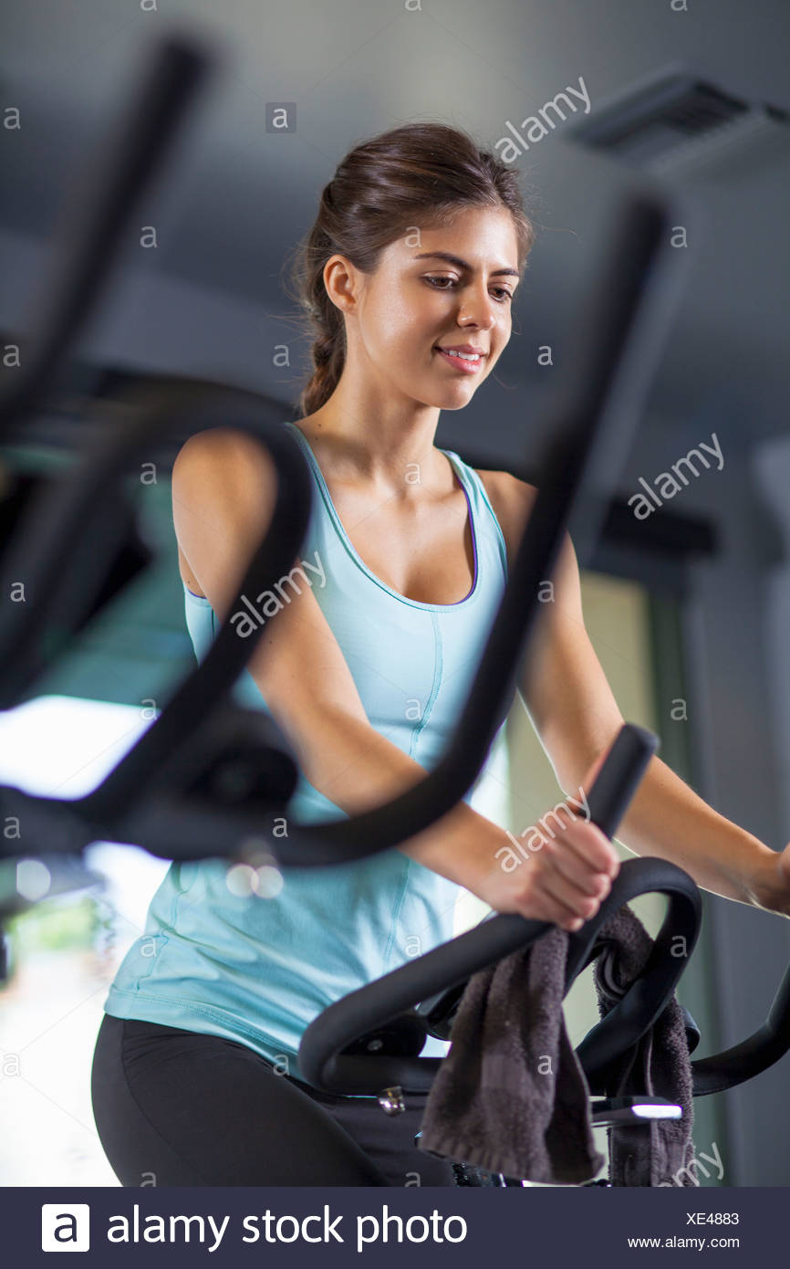 Young woman on cross-trainer Stock Photo