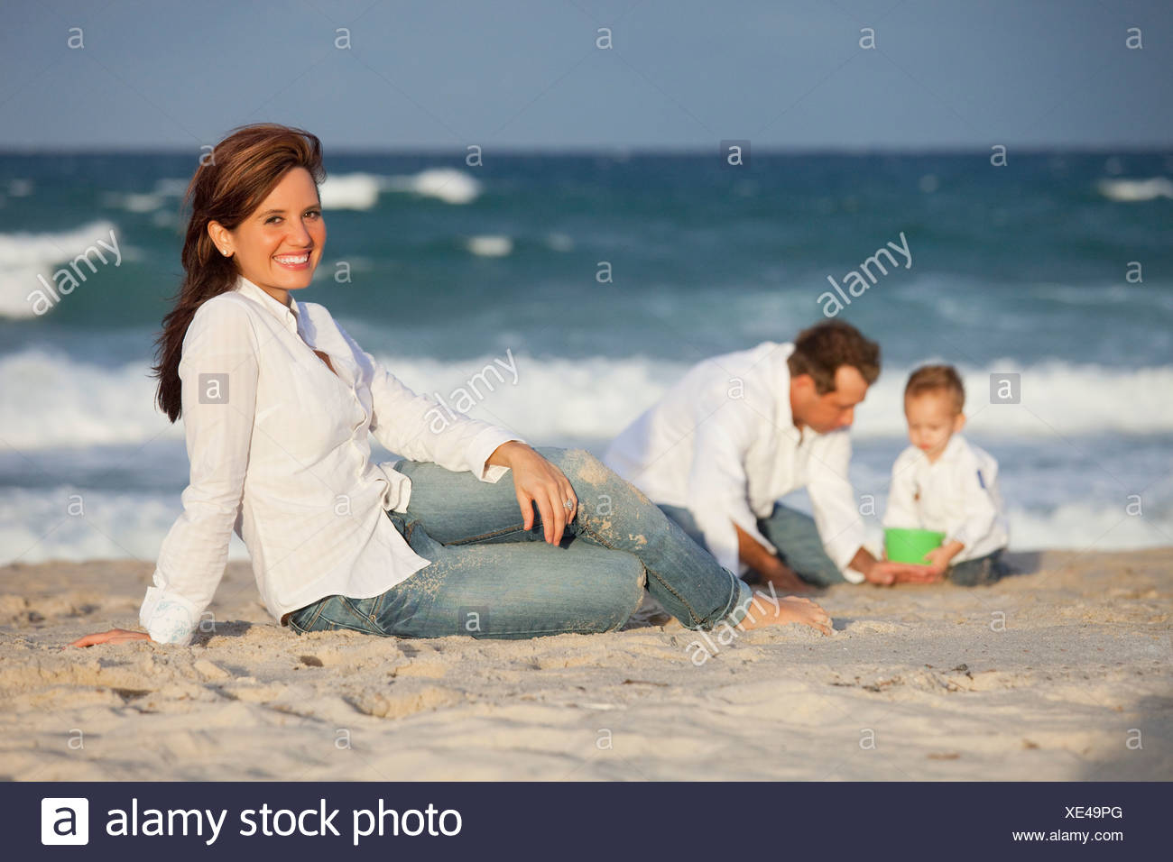 Fort Lauderdale, Florida, United States Of America; A Woman On The Beach With Her Family - Stock Image