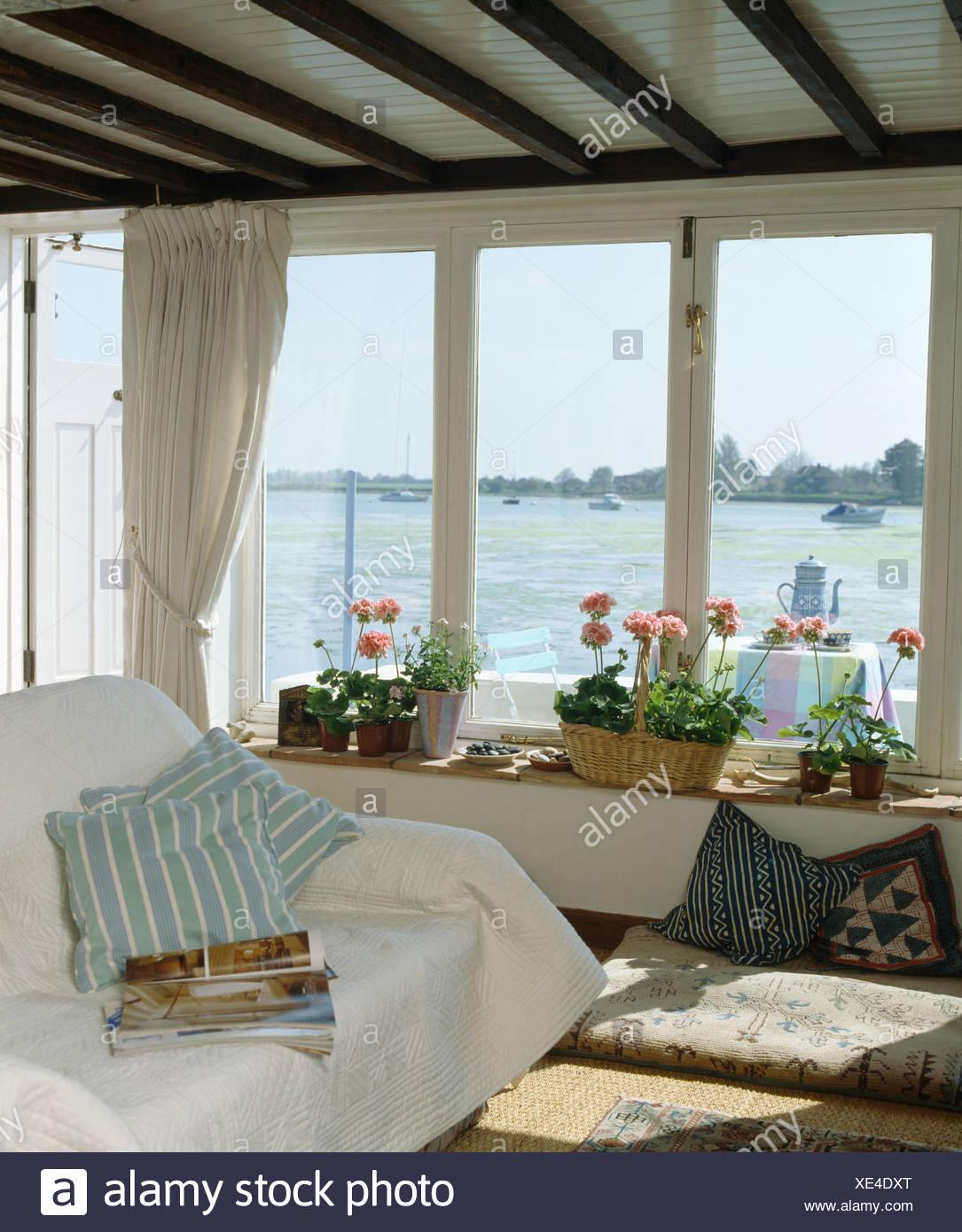 White Throw And Blue Striped Cushion On Sofa In Coastal