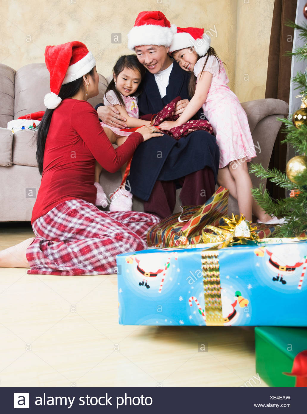 Asian family bonding on Christmas morning - Stock Image