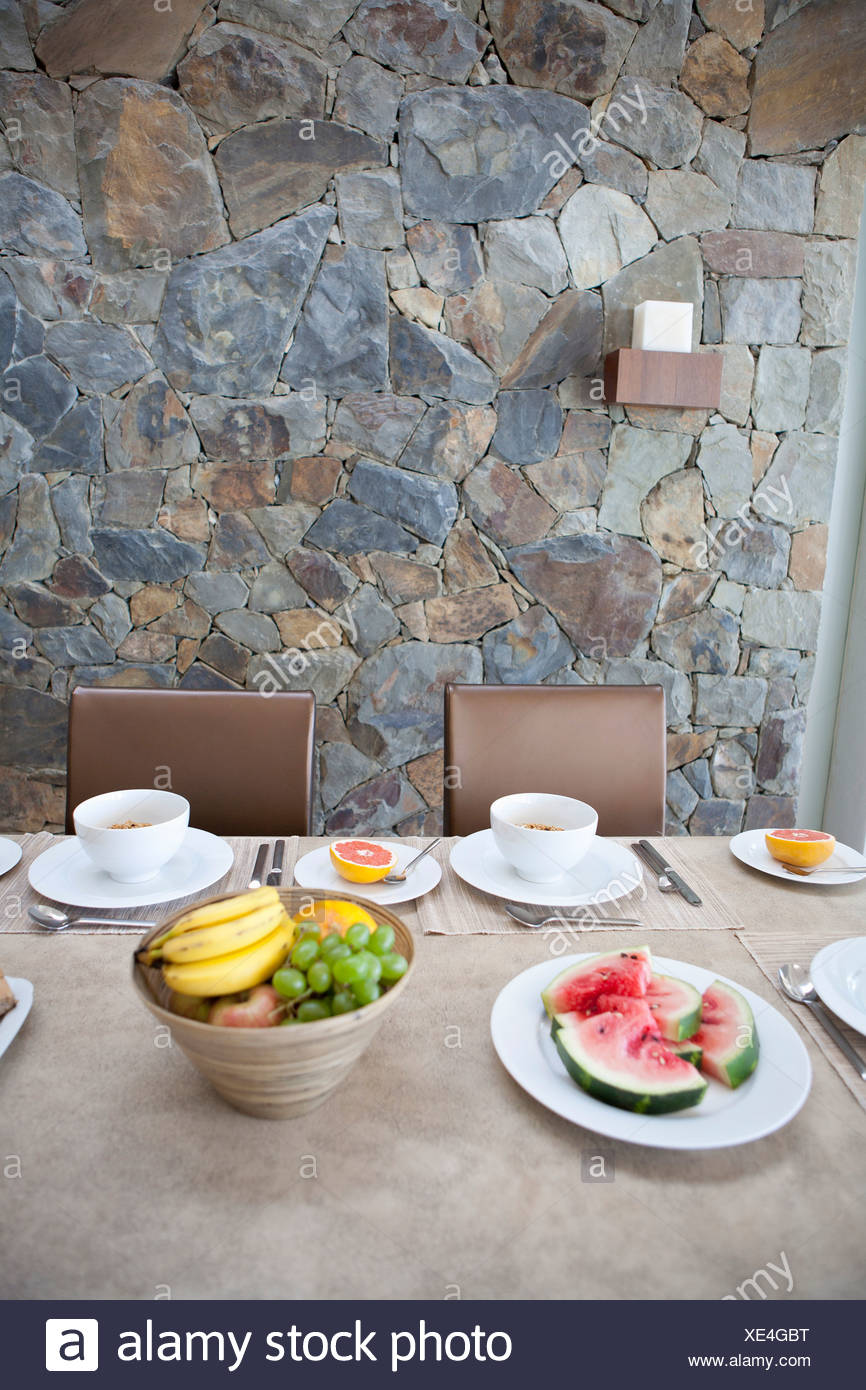 Place settings on breakfast table - Stock Image