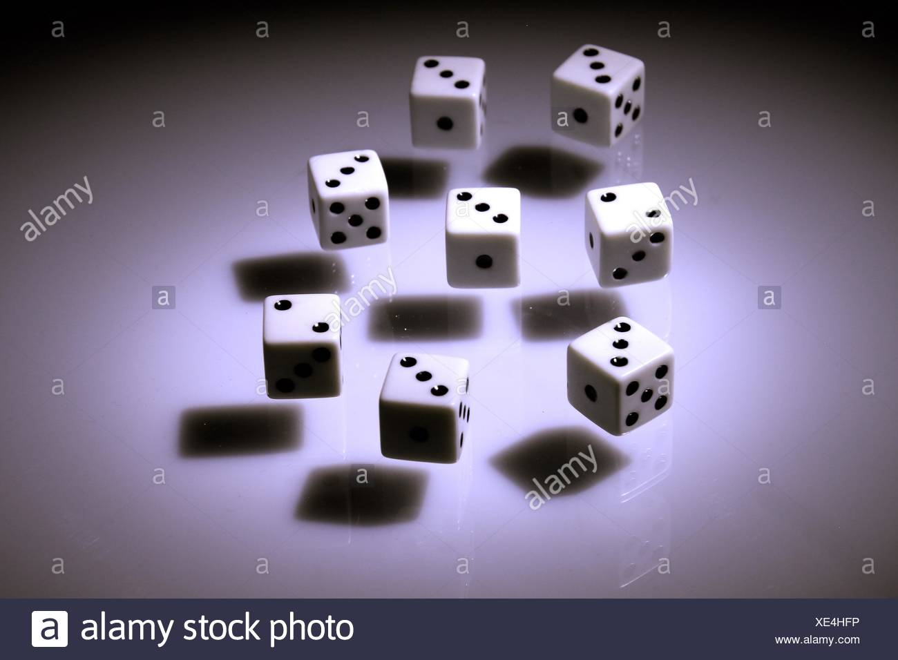 High Angle View Of Dice Against Colored Background - Stock Image