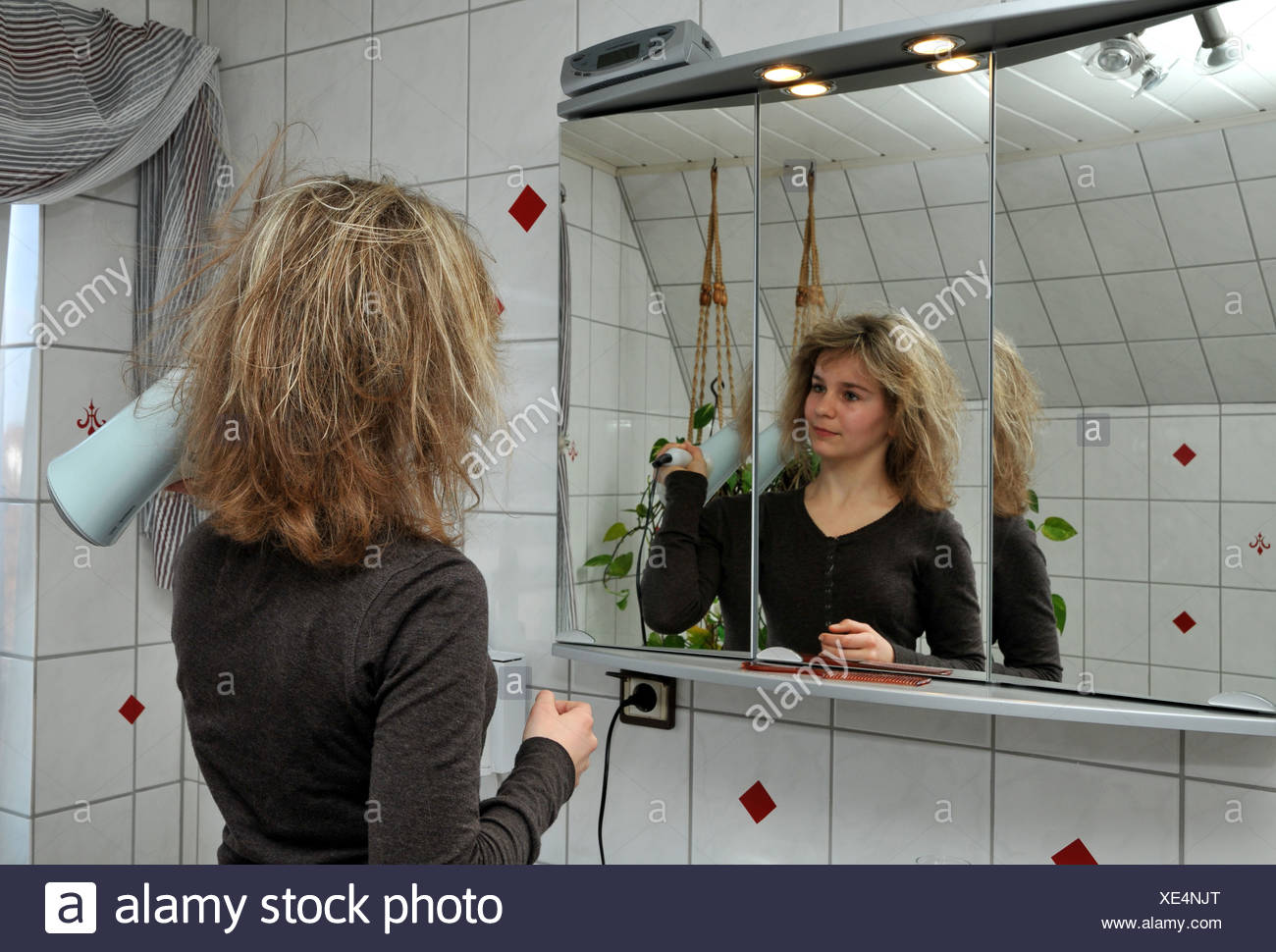 blow dry hair - Stock Image