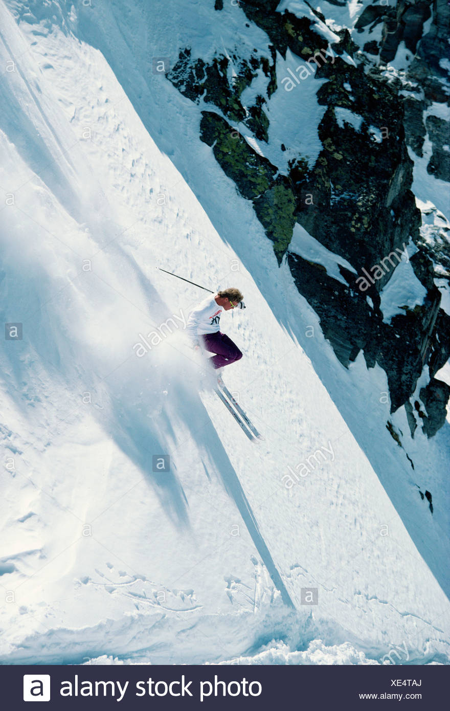 Young man downhill skiing. - Stock Image