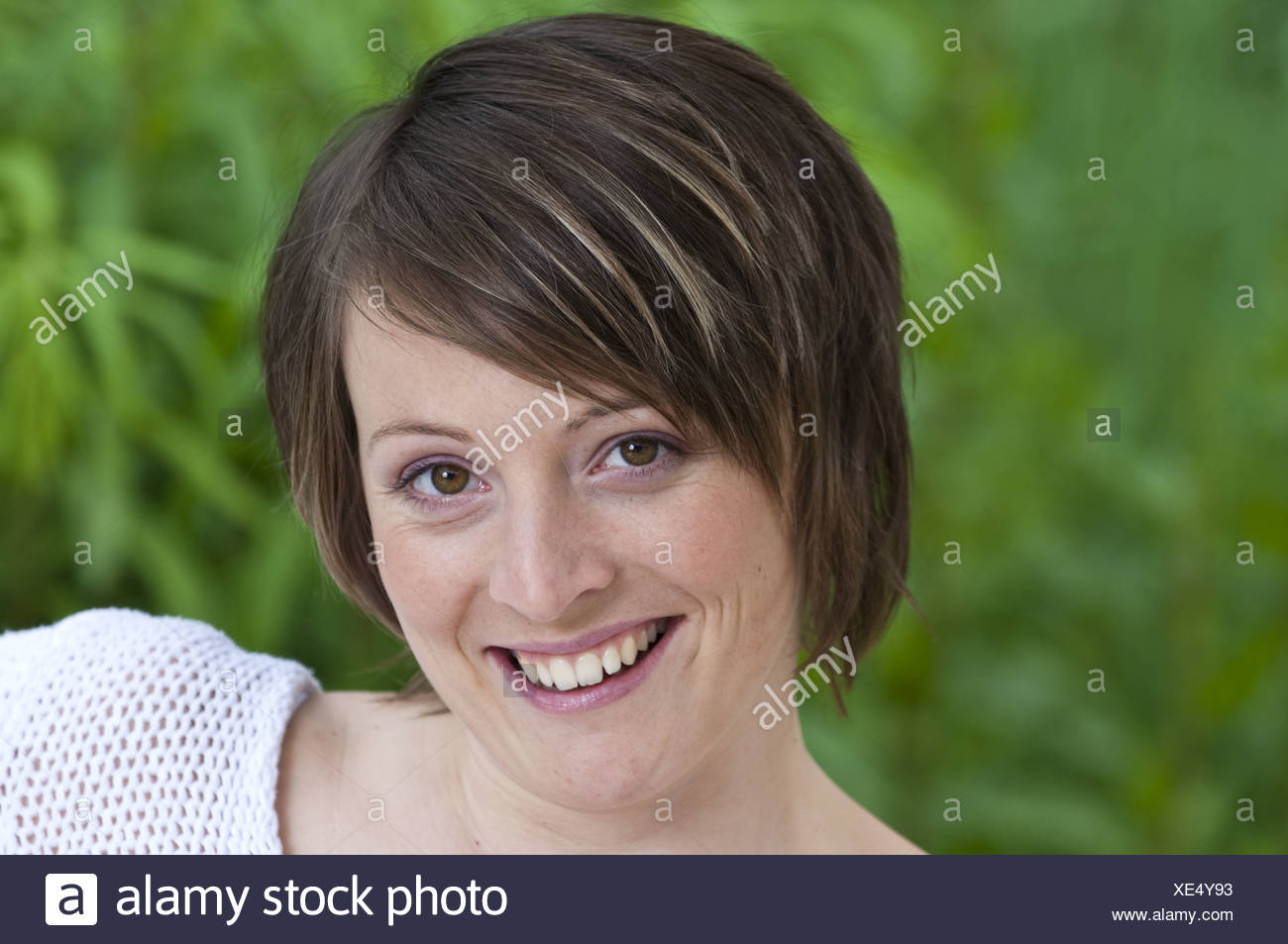 woman laughing cheerfully (model-released) - Stock Image
