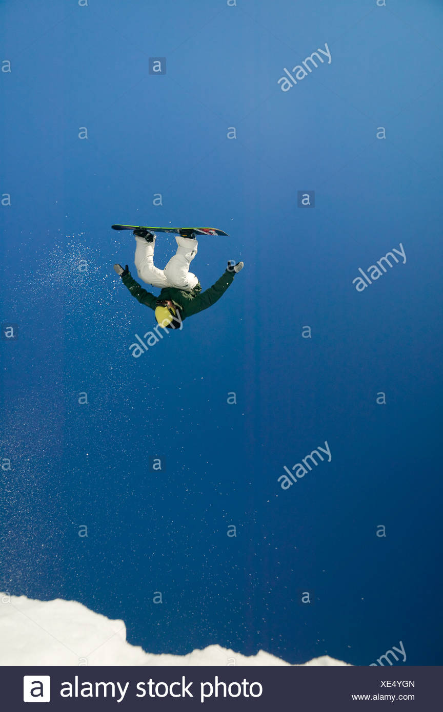 Inverted competitor at Slopeside competition up at Mt. Washington.  Vancouver Island, British Columbia, Canada - Stock Image