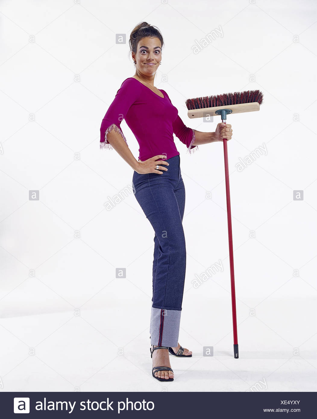 Woman, young, brooms, gesture, energetically, decided, grab women, housewife, vigorously, clean unerringly, determination, clean, sweep, studio, cut outs, - Stock Image