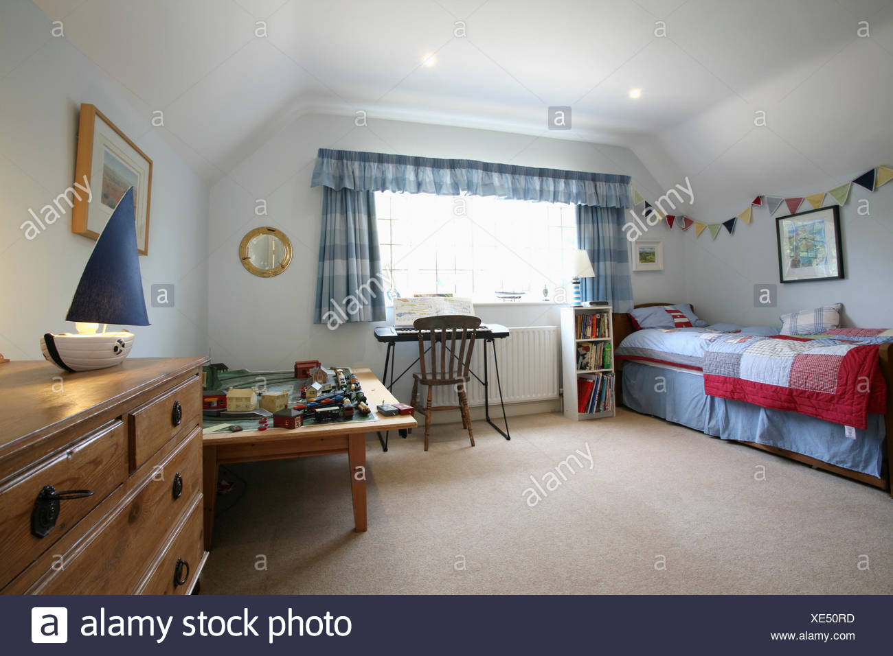 Cream carpet and blue & white checked curtains in boy\'s ...