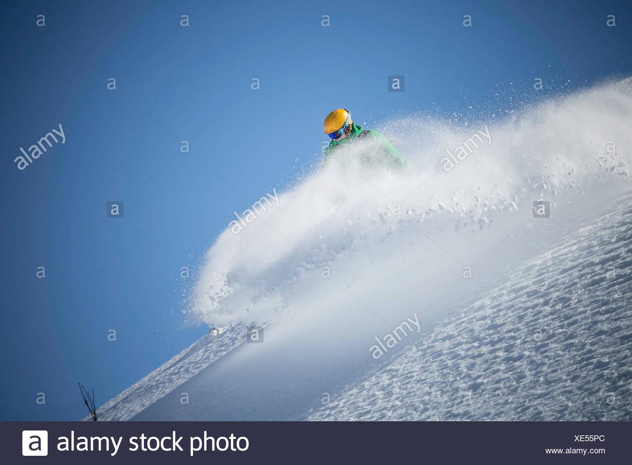 Snowboarder, downhill skiing, Powderspray Stock Photo