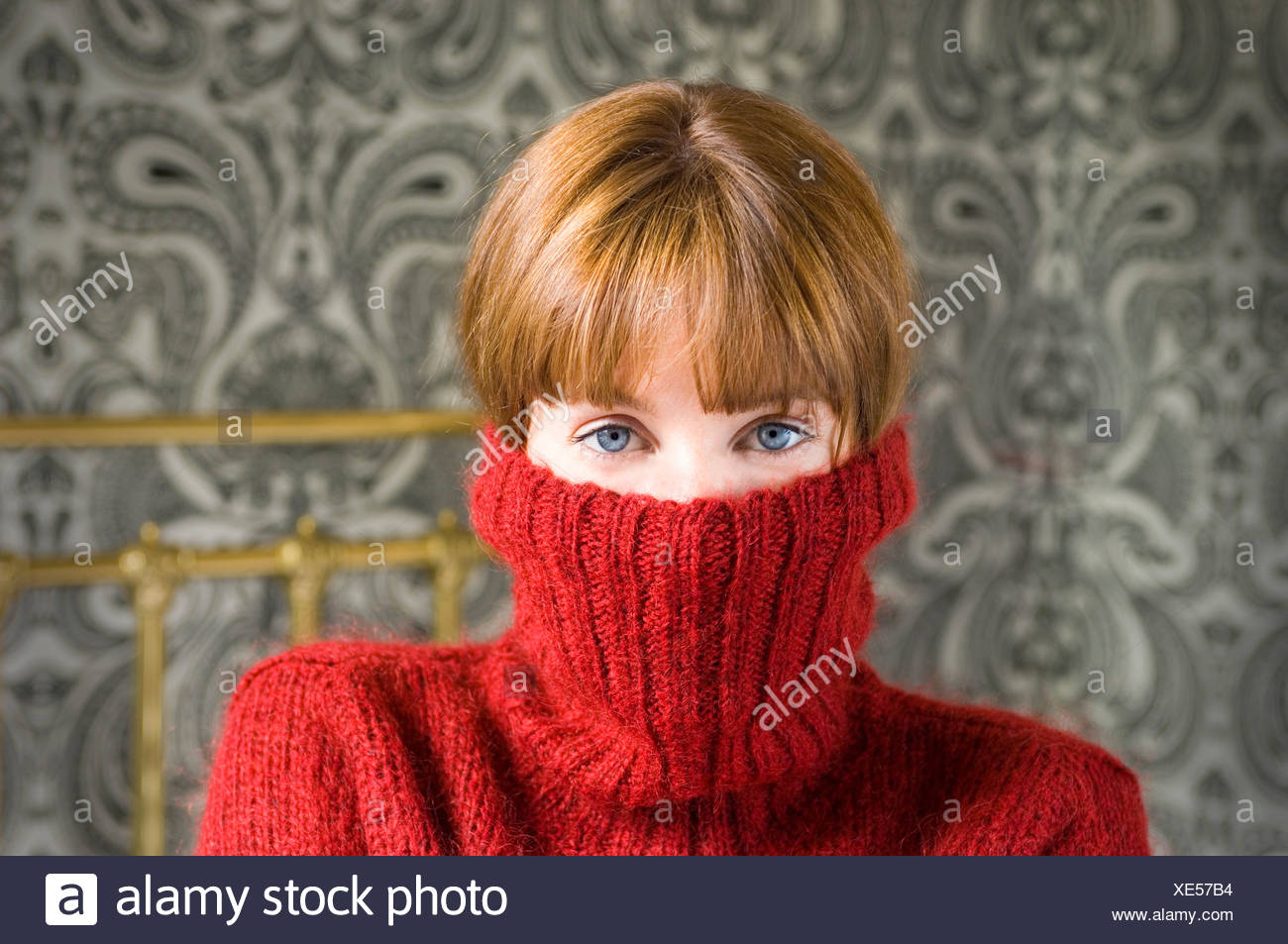 woman with jumper pulled over face - Stock Image