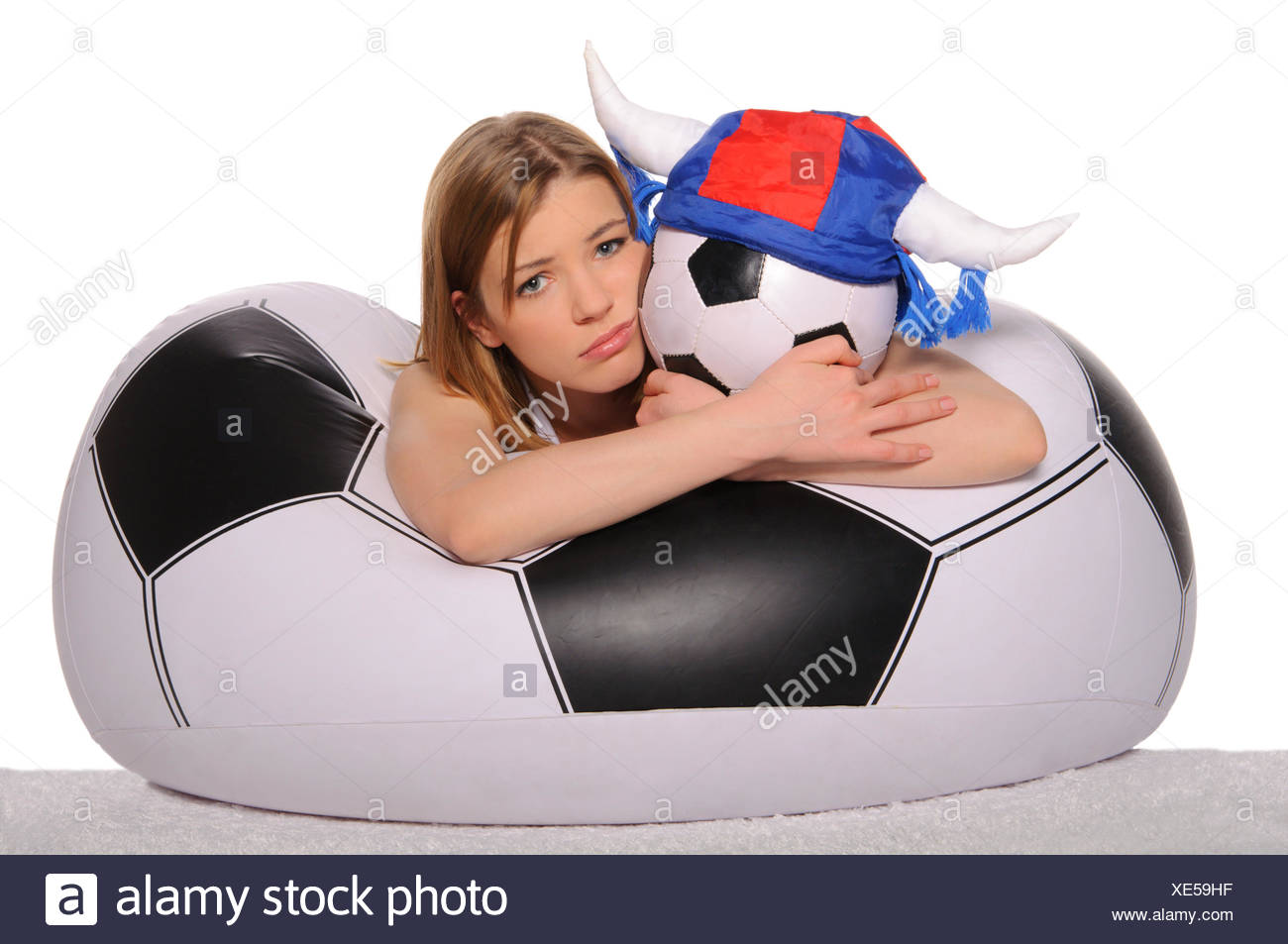 Distressed football cheerleader with  ball - Stock Image
