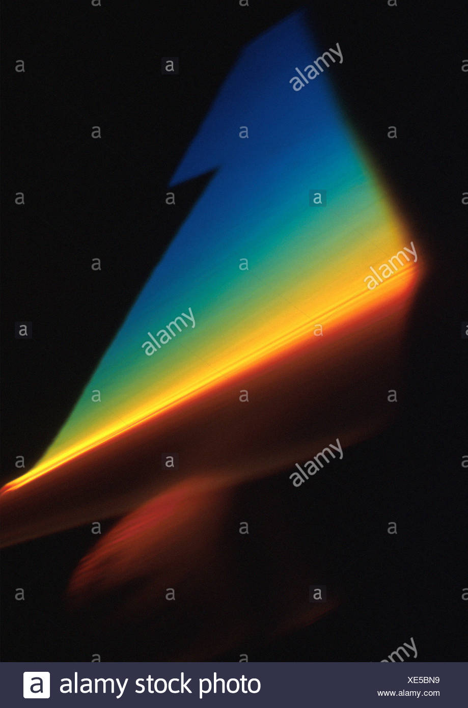 Light effect, triangular, rainbow colors. - Stock Image