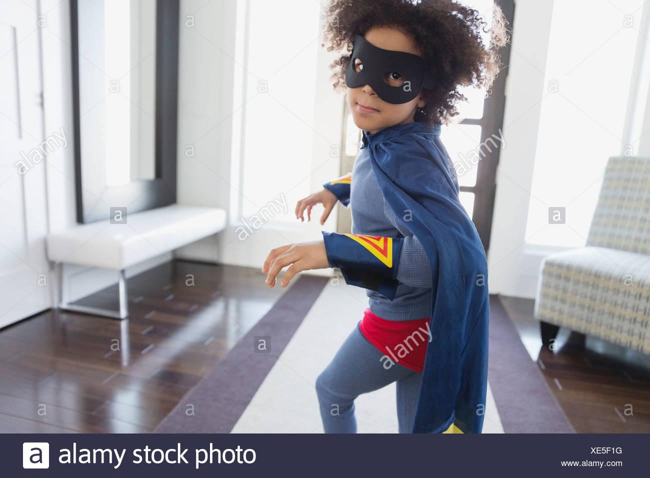 Boy pretending to be superhero at home - Stock Image