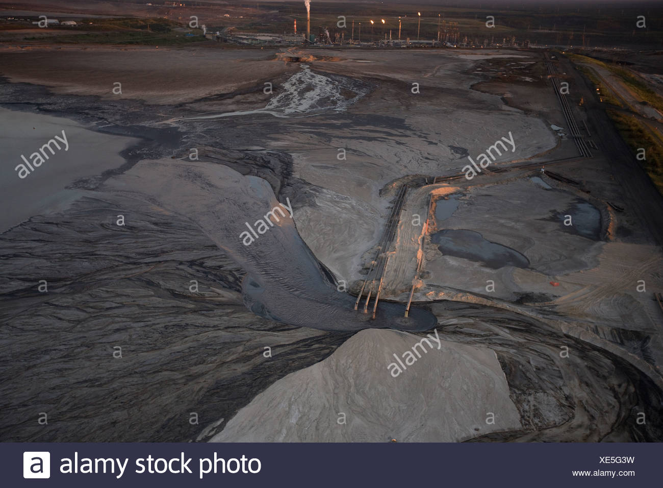 Tailings Pond outflow pipes from the Bitumen Separation Plant, Suncor Millenium oil sands mine north of Fort McMurray, Alberta, - Stock Image