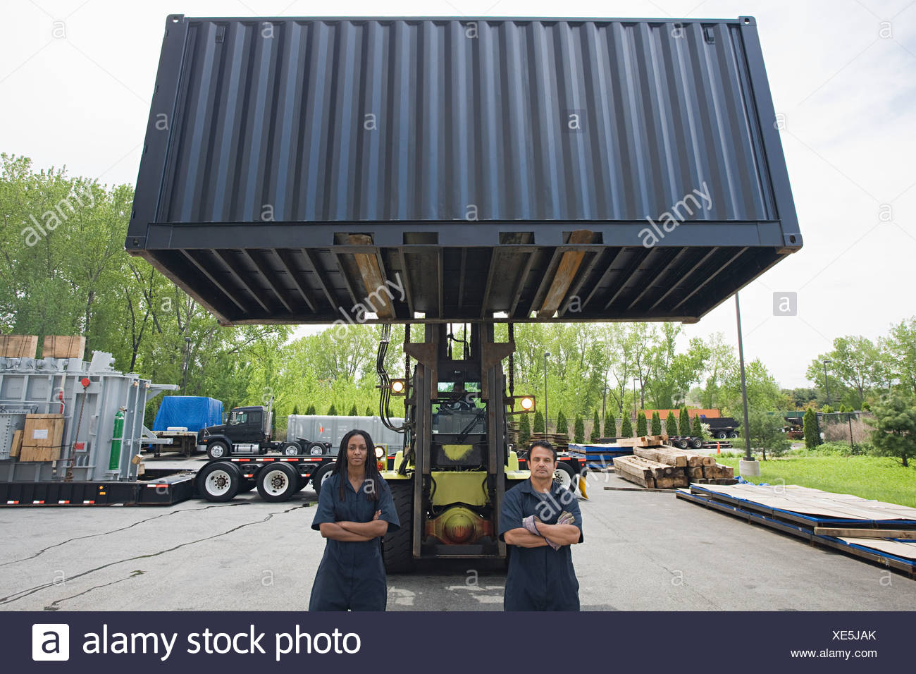 Colleagues by forklift truck Stock Photo