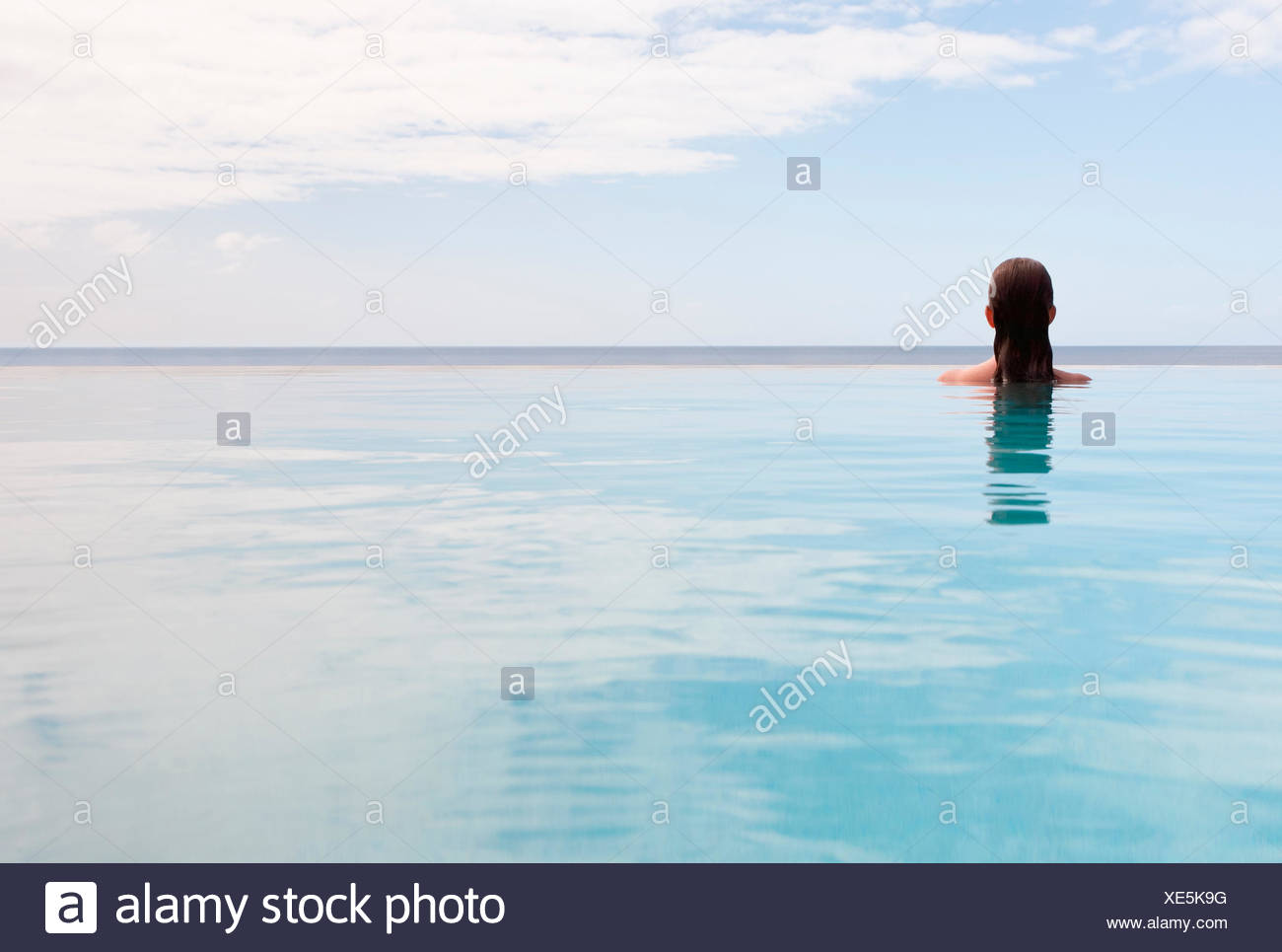 USA, Virgin Islands, St. John, Woman in swimming pool - Stock Image
