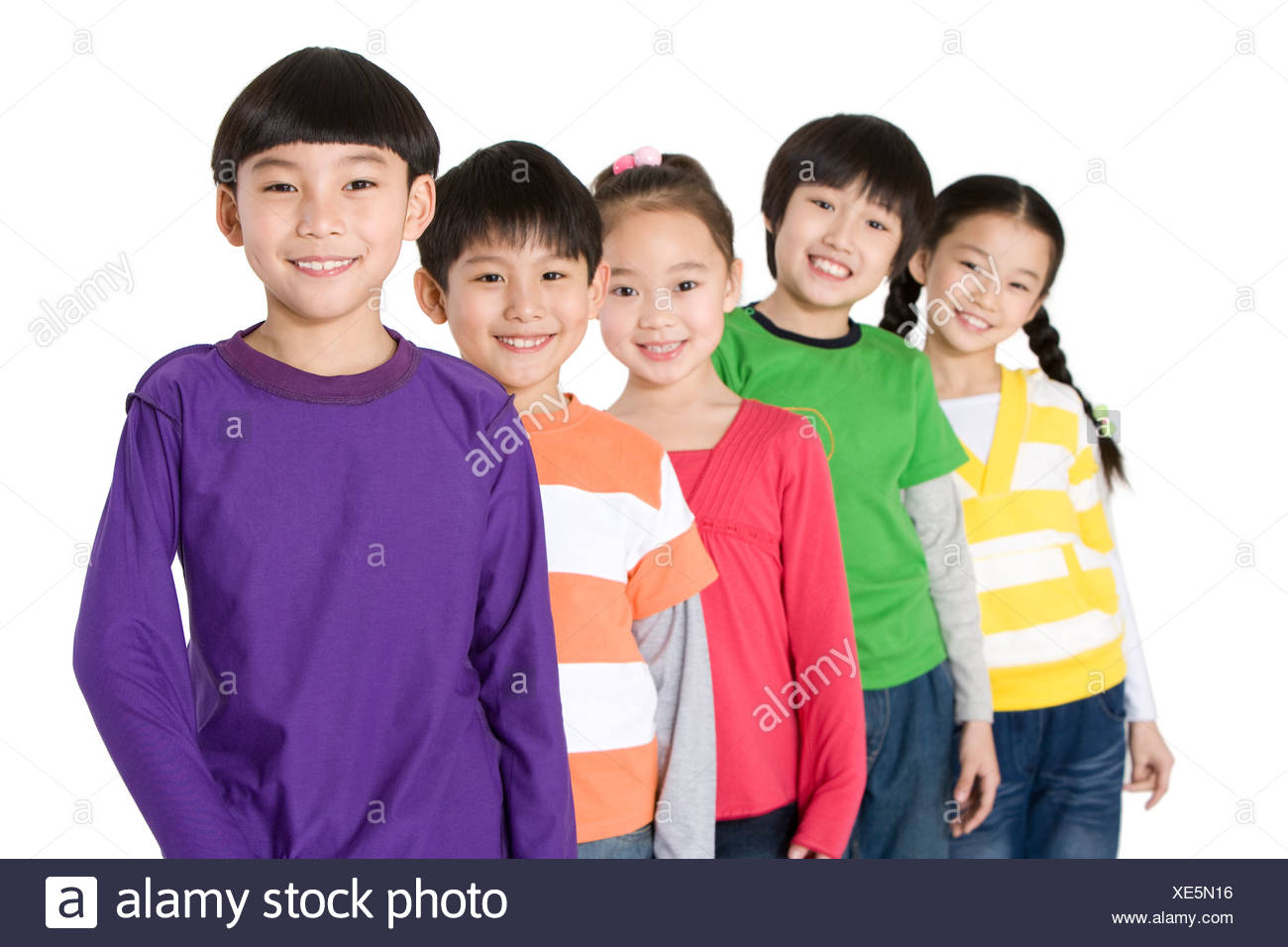 A group of friends standing in a row - Stock Image