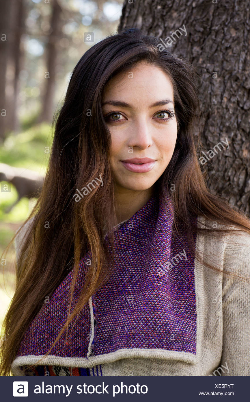 Portrait of young woman with long brown hair - Stock Image