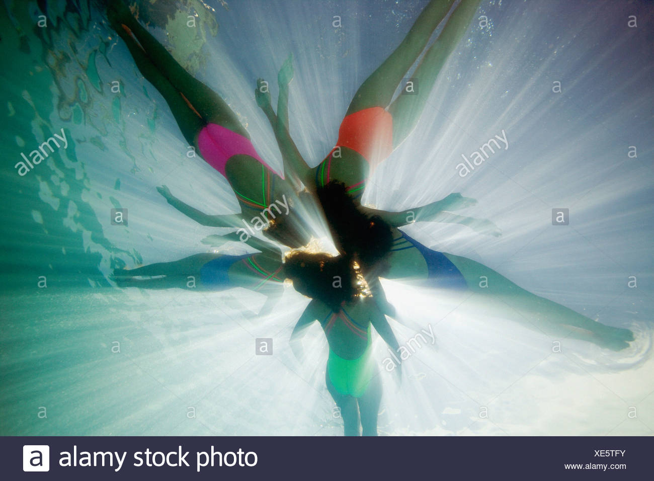 Underwater shot of synchronised swimmers - Stock Image