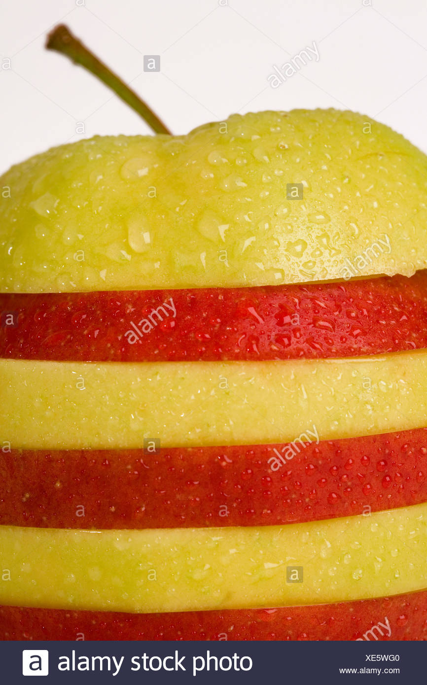 Slices of green and red apple - Stock Image
