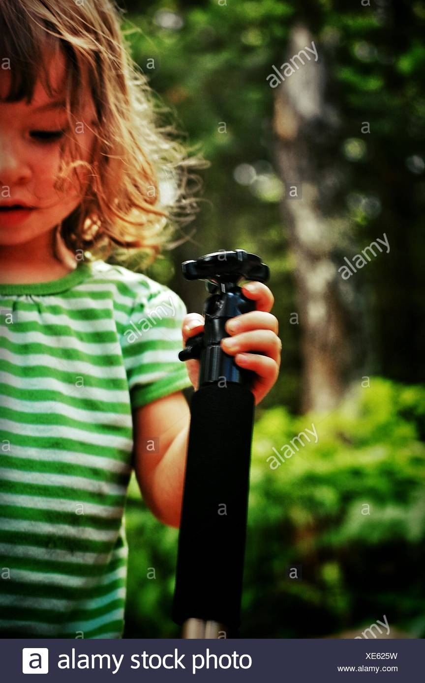 Girl Holding Bottle In Park - Stock Image