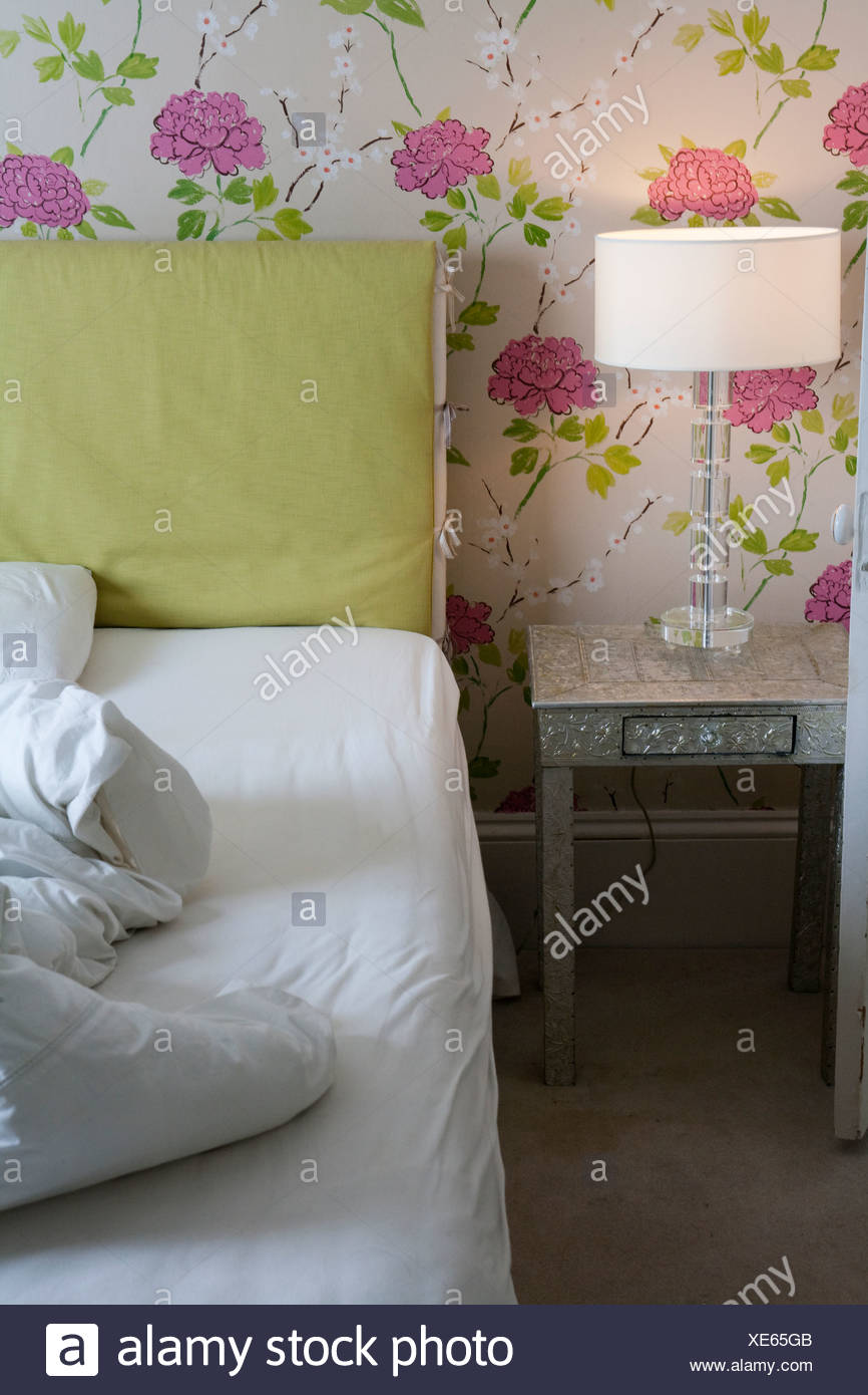 Bedroom with crumpled duvet on bed - Stock Image